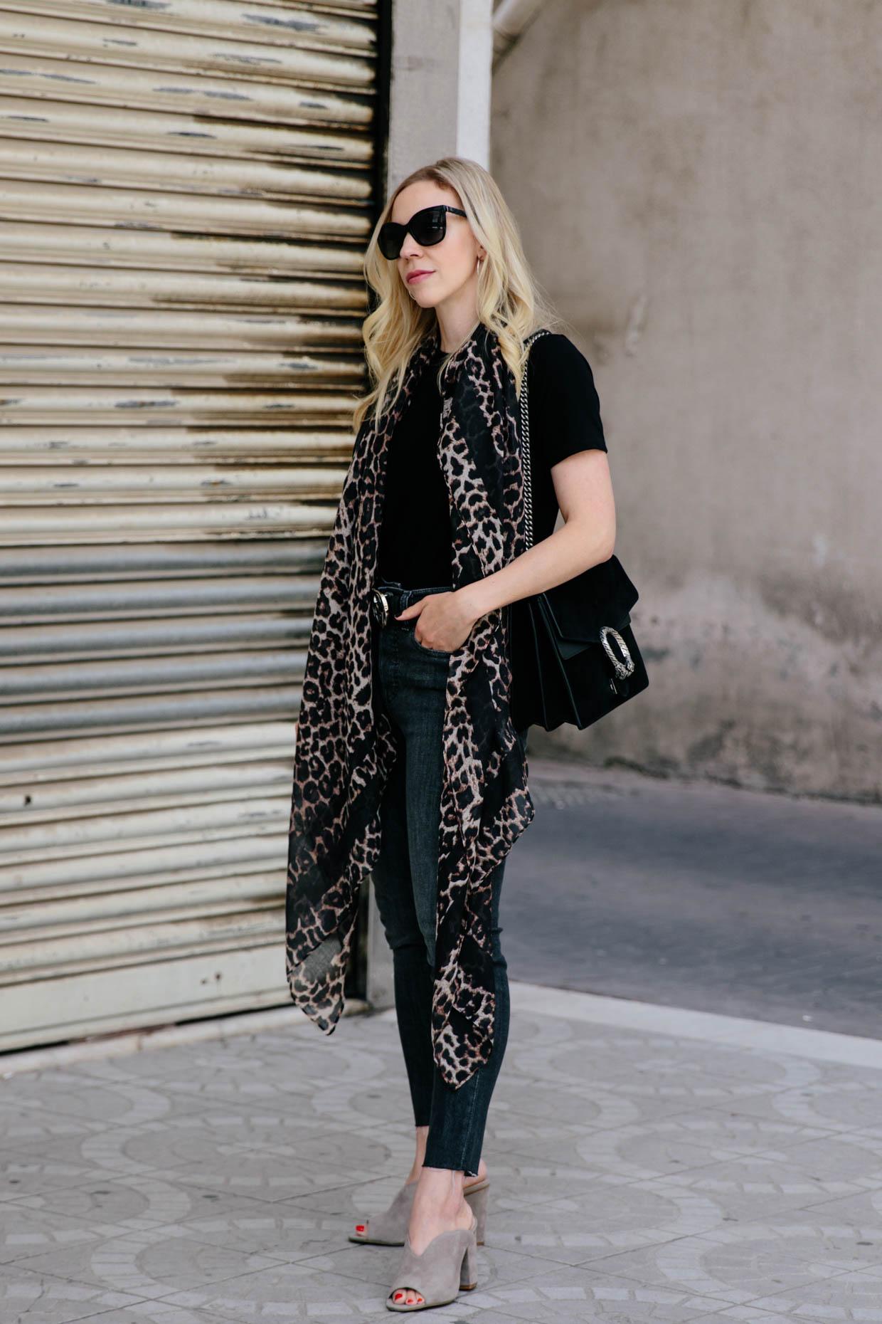 4c4a2753186 Meagan Brandon fashion blogger of Meagan s Moda wears leopard print scarf  with high waist gray jeans
