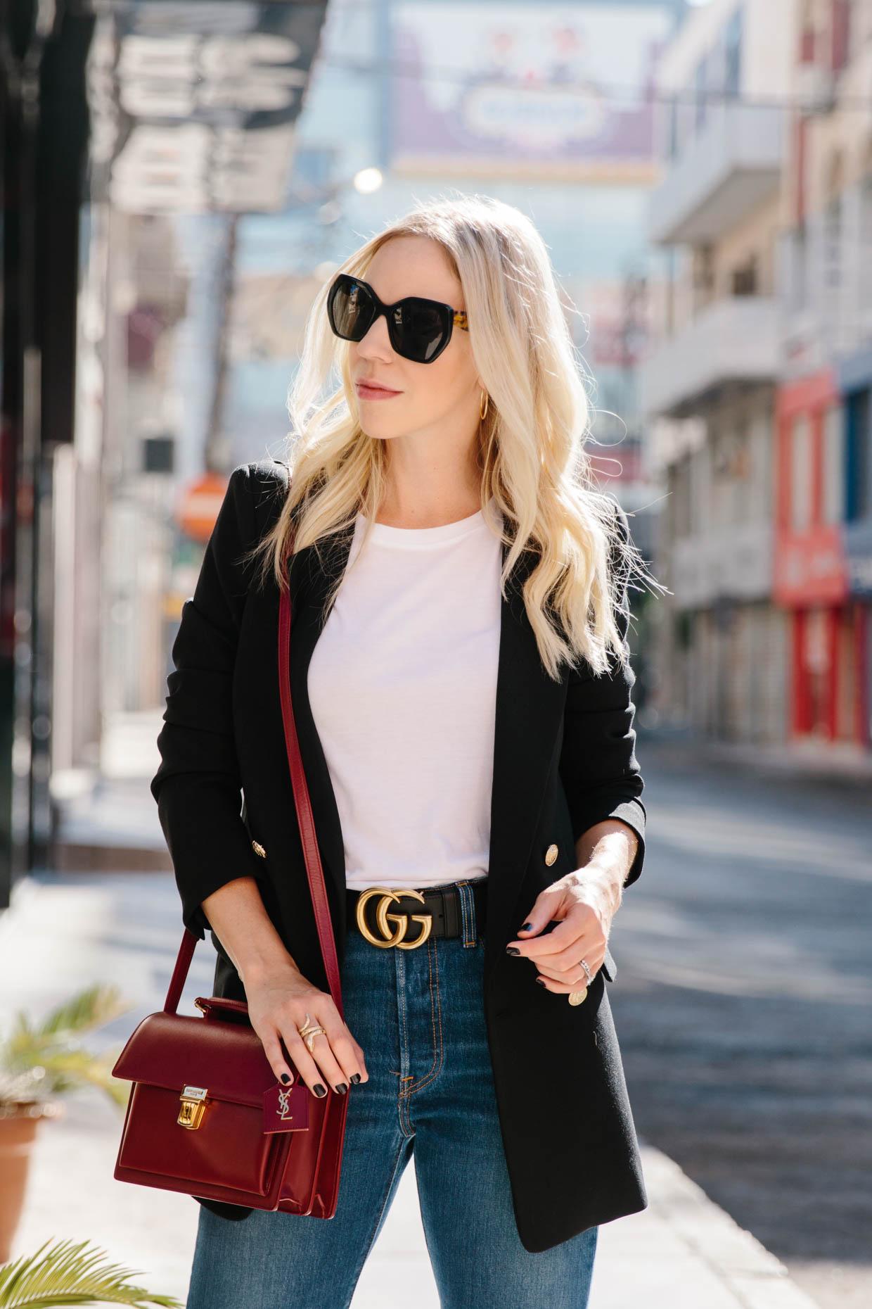 3409078c4bf Meagan Brandon fashion blogger of Meagan s Moda wears black double breasted  blazer with white tee
