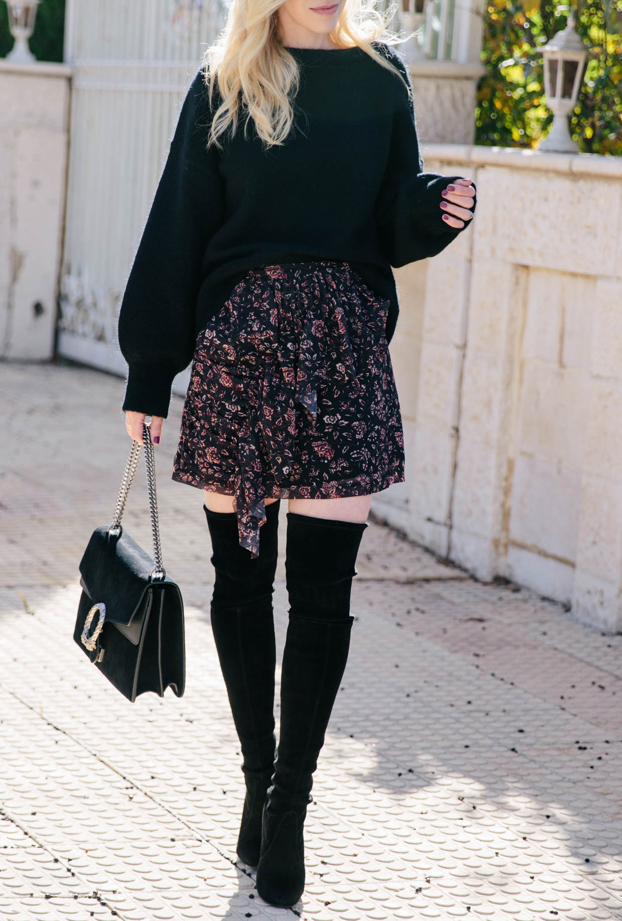 bd42293cde843 How to wear a floral print ruffle mini skirt with black suede over the knee  boots and Gucci Dionysus bag