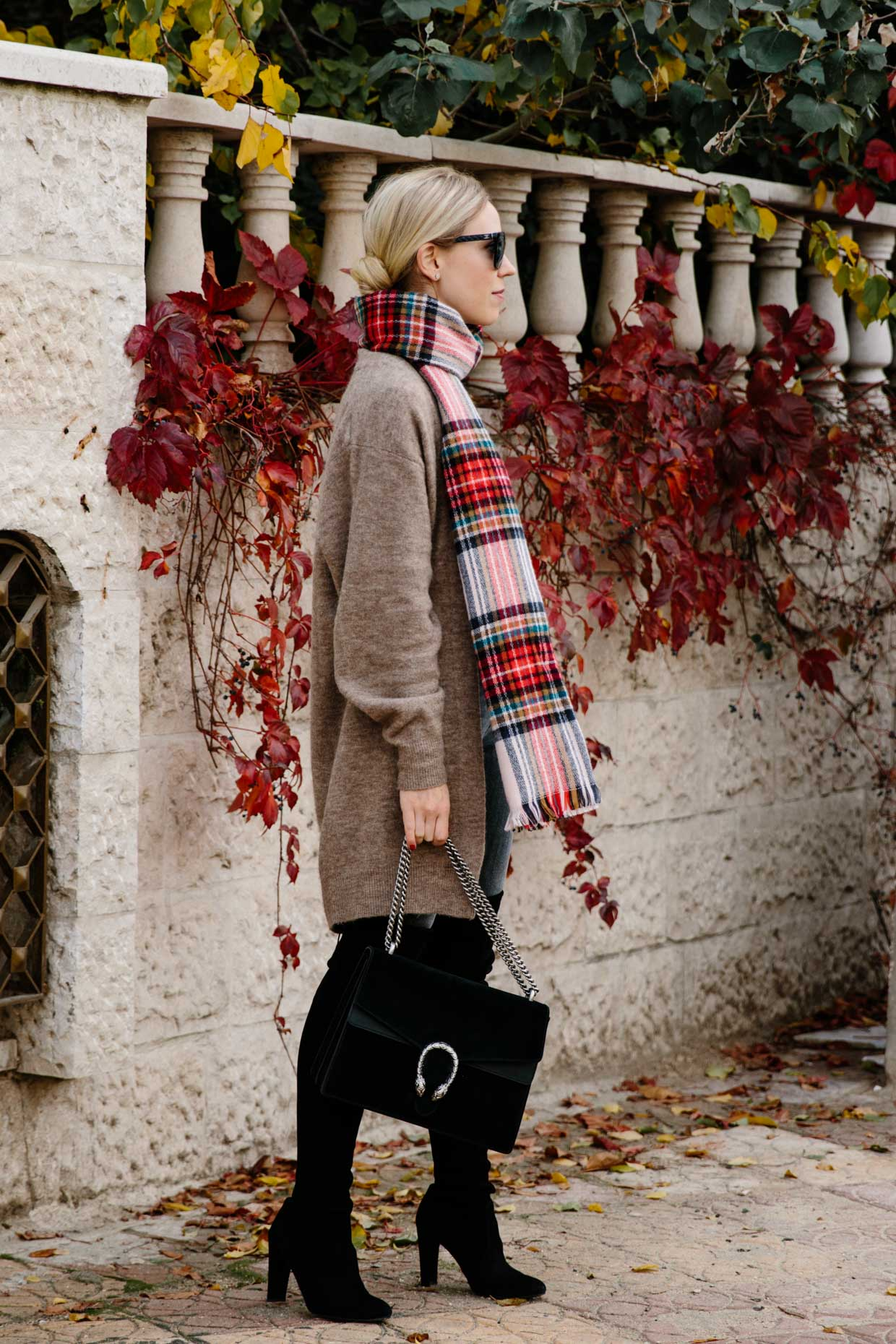 22c16bf87095e Chic holiday outfit with long tan cardigan, red plaid scarf, black over the  knee boots and Gucci Dionysus bag