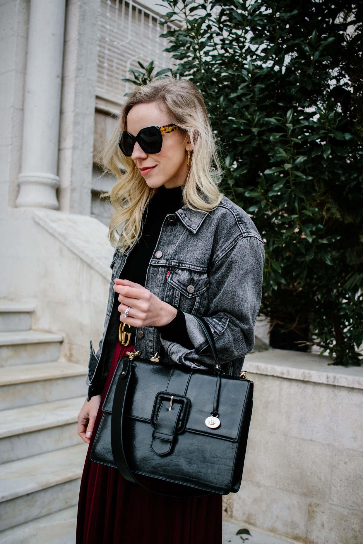 Meagan Brandon fashion blogger styles Levi's black denim jacket with Brahmin Francine satchel
