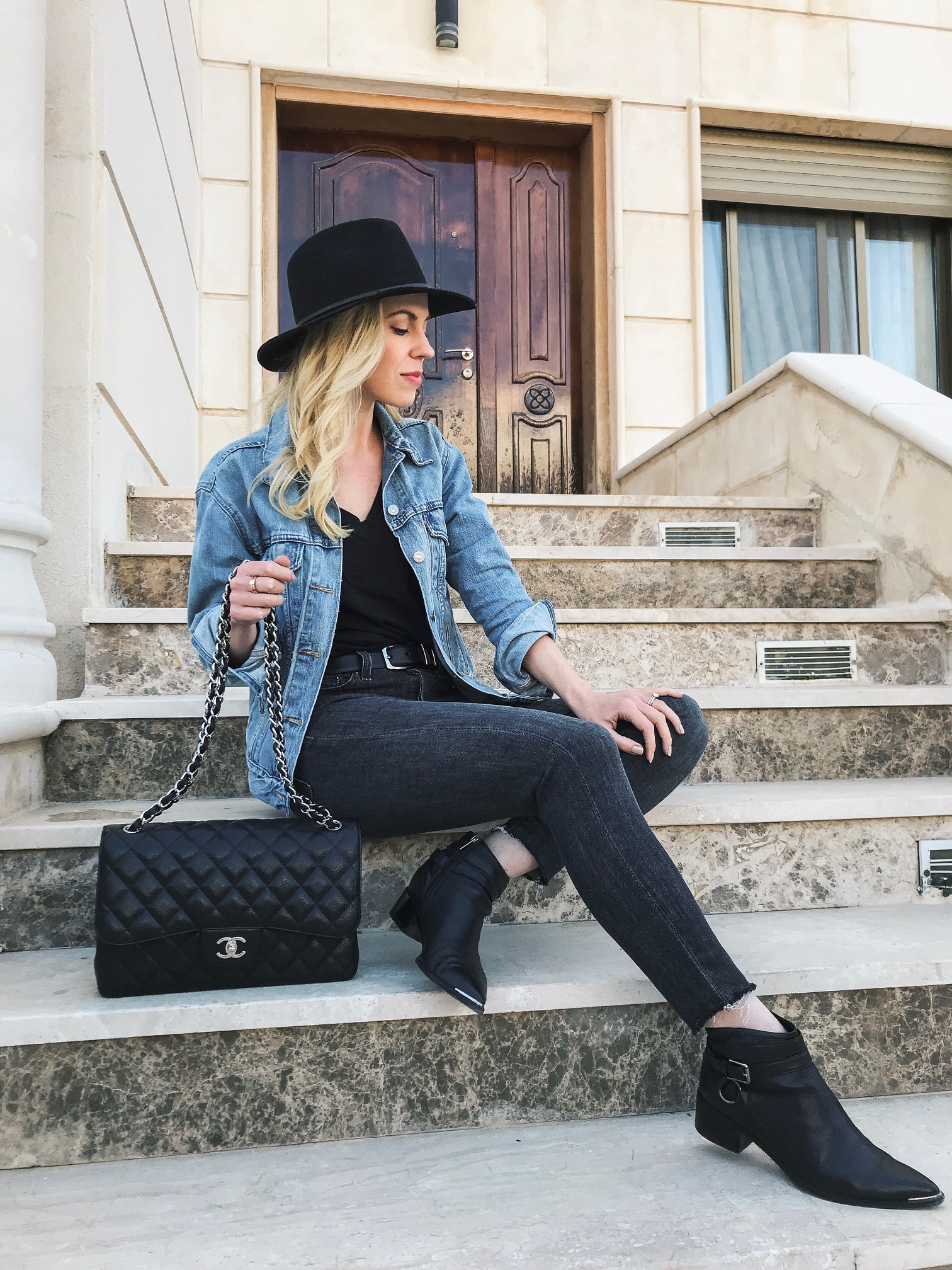 Meagan Brandon fashion blogger of Meagan's Moda shares closet essentials under $75 including Levi's denim jacket and jeans