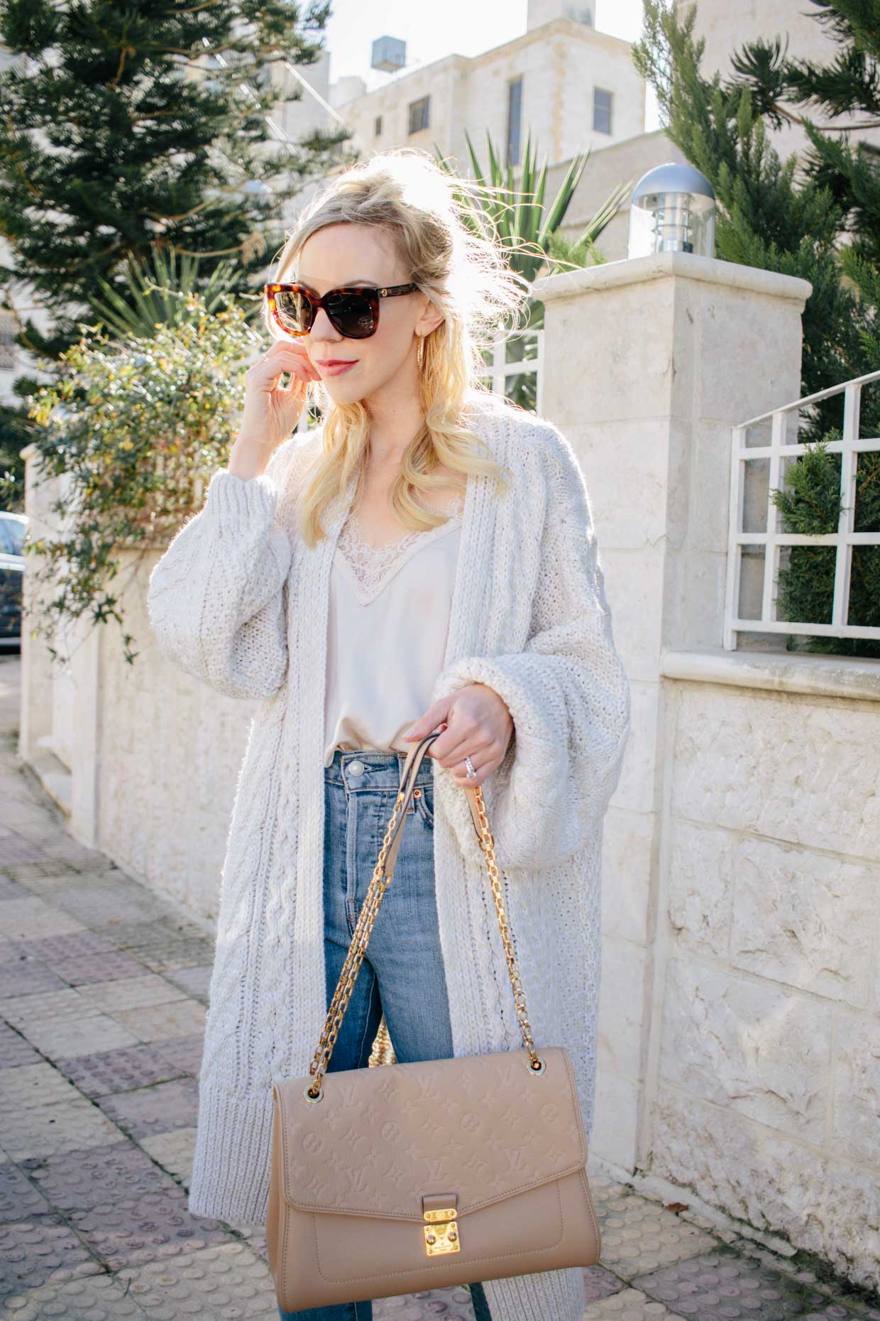 48a8f6f7569b2f Meagan Brandon fashion blogger of Meagan s Moda shows how to wear an  oversized cardigan with lace camisole for chic spring outfit idea