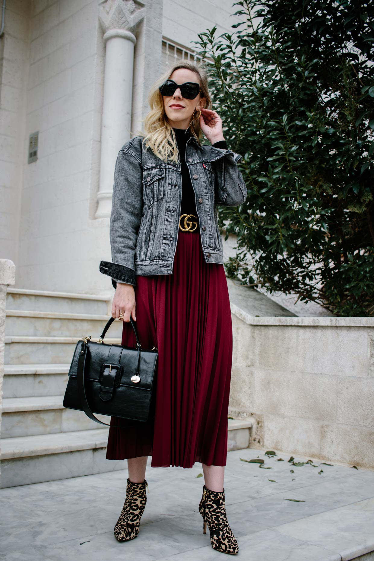 670c43ff256 Meagan Brandon fashion blogger of Meagan's Moda shows how to style a  burgundy pleated skirt with