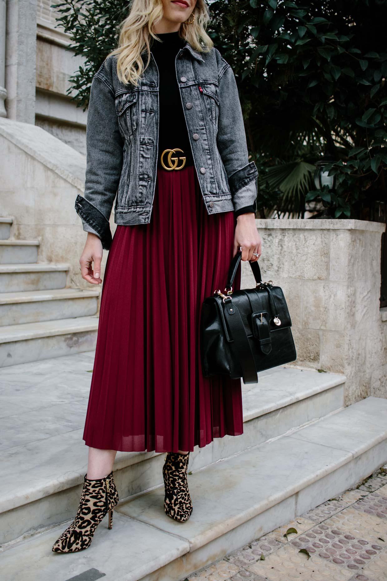 086473d22c Meagan Brandon fashion blogger of Meagan's Moda wears black denim jacket  with Gucci belt, burgundy pleated midi skirt and leopard print boots, ...