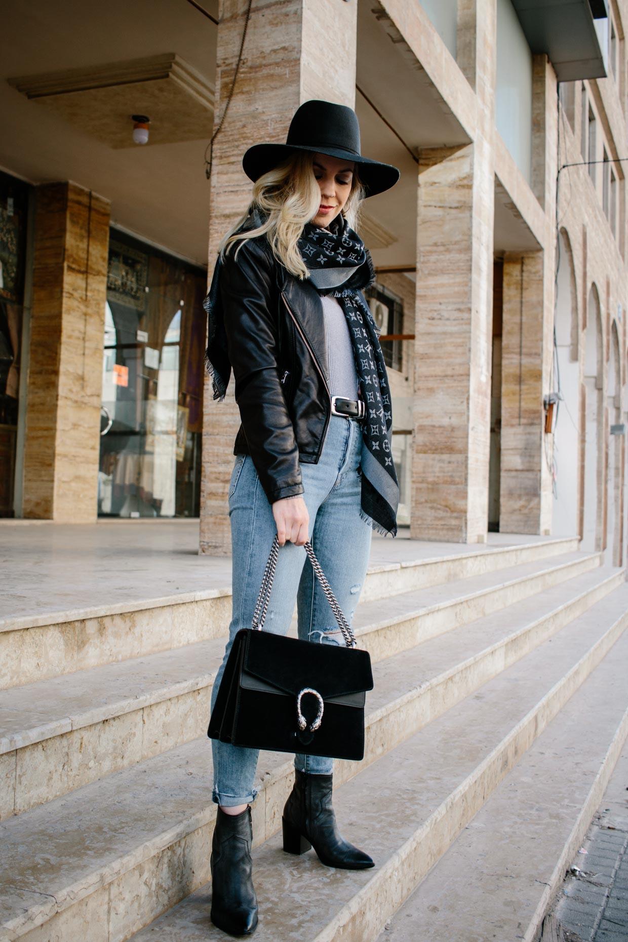 40510b689ba Meagan Brandon fashion blogger of Meagan s Moda wears black leather jacket  with Louis Vuitton shine shawl