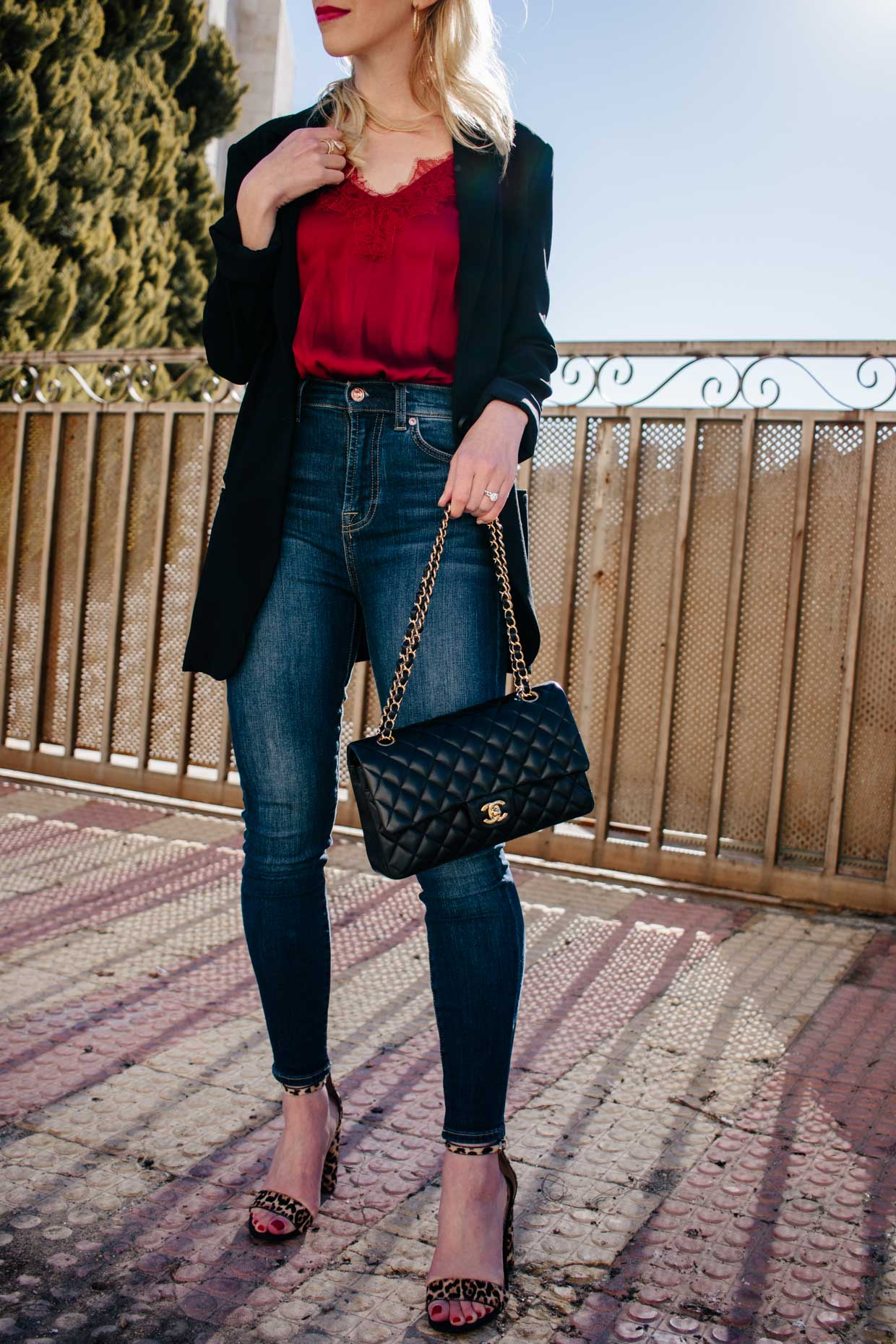 b41ff34198b6 Meagan Brandon fashion blogger of Meagan s Moda wears long black blazer  with red lace camisole