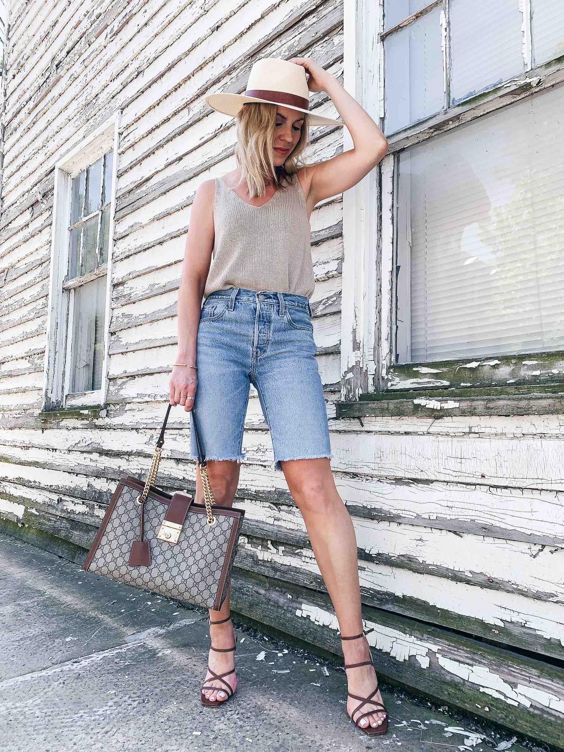 Meagan Brandon fashion blogger of Meagan's Moda wears Levi's knee length shorts with stiletto heels, how to wear bermuda shorts and look stylish - Meagan's Moda
